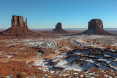 Monument Valley, Navajo Nation at sunrise in the light on rising sun — Stock Photo