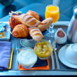 Continental breakfast with croissant, jam, coffee and orange jui — Stock Photo #51855505