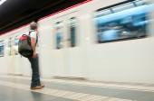 Man waiting train in subway platform — ストック写真