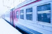 Train in a snowstorm at railroad platform — Stock Photo