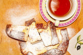 Homemade pie with cheese and cup of tea — Stockfoto