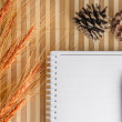 Blank notepad notebook with pencil on brown bamboo background — Stock Photo #76706417