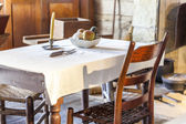 Table and chair in very old kitchen — Stockfoto