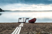 Peaceful place, lake, boat and jetty — Stock Photo