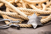 Sheriff badge, spurs and lasso. — Stock Photo