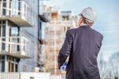Construction manager with blueprints — Stock Photo