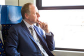 Serious businessman sitting in a train — Stock Photo
