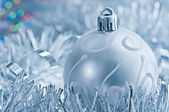 Silver Christmas ball and garland. Greeting card with space for  — Foto de Stock