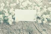 Gypsophila flowers on old wooden board. Card in retro style with — Stock Photo
