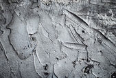 Texture of a concrete wall with dabs of cement and hard putty — Stock Photo