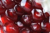 Macro of fresh red pomegranate grains close up — Stok fotoğraf