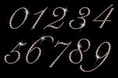 Set of numbers made with rhinestones on black background — Stock Photo