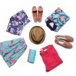 Collection of bright summer clothes. On a white background is a circle — Stock Photo #77704674