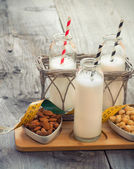 Different vegan milks on a table. Substitute for dairy milk. — Stock Photo