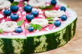 Watermelon pizza on wood — Stock Photo