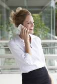 Businesswoman talking on cell phone — Stock Photo