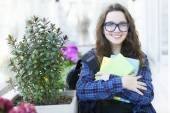 Beautiful female student with book — Stock Photo