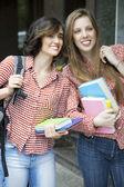 Gorgeus girls going to university — Stock Photo