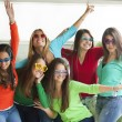 Smiling teenagers with funny glasses — Stock Photo #70450829