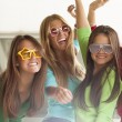 Smiling teenagers with funny glasses — Stock Photo #70451321