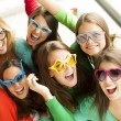 Smiling teenagers with funny glasses — Stock Photo #70452209