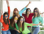 Smiling teenagers with funny glasses — Stock Photo