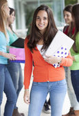 Smiling teenagers with exercise books — Stock Photo