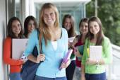 Smiling teenagers with exercise books — Stockfoto