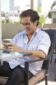 Young  office man speaking on smart phone — Stock Photo