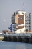 GABCIKOVO, SLOVAKIA - NOVEMBER 01, 2013: Control tower of the Gabcikovo Dams on Danube river with tourists on a good weather autumn day — Stock Photo