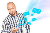 Handsome man using smartphone for receive and send sms — Stock Photo
