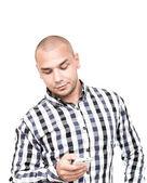 Gut aussehender Mann mit Smartphone für Receive und Send sms — Stockfoto