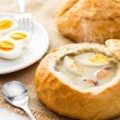 Polish Easter soup. Cream soup in bread — Stock Photo #67926947