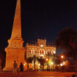 Постер, плакат: Menorca Balearic Islands: the obelisk and the Town Hall in Es Born Square in Ciutadella at nigh