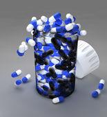 Blue and white pills in bottle — Stockfoto