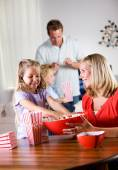Family: Young Girl Helps Mother With Popcorn — Stock Photo
