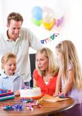 Birthday: Mother Blowing Out Birthday Cake Candle — Foto de Stock