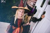 Halloween: Little Girl Waits For Door To Open On Front Porch — Foto de Stock