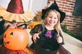 Halloween: Smiling Little Girl Witch Witch Candy Cauldron — Stock Photo