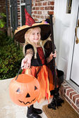Halloween: Girl Witches On Porch Ringing Doorbell — Stock Photo
