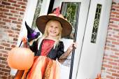 Halloween: Smiling Witch After Getting Trick Or Treat Candy — Стоковое фото