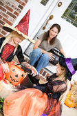 Halloween: Girls Sit On Front Porch Checking Candy — Foto de Stock