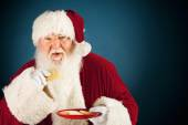 Santa: Eating a Sugar Cookie — Stockfoto