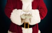 Santa: Santa Holding Fanned Out Cash — Stockfoto
