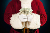 Santa: Santa Holding Fanned Out Cash — Stock Photo
