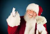Santa: Santa Holding Fanned Out Cash — Stock Photo
