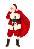 Santa: Santa Claus Carrying Sack of Presents — Stock Photo