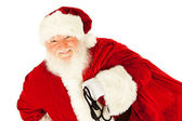 Santa: Santa Claus Carrying Sack of Presents — Stockfoto