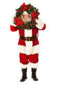 Santa: Peeking Through Christmas Wreath — Photo