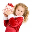 Christmas: Girl Holds Up Christmas Present And Shakes To Guess W — Stock Photo #53196173